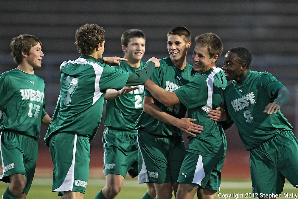 West's Ben Troester (17), Aaron Miller (7), Ryan O'Deen (2), Bryton Ostler (19), and Mueng Sunday (9) celebrates after Alex Troester's (second on right) goal during the game between Iowa City West and Cedar Rapids Washington at Kingston Stadium in Cedar Rapids on Monday evening, April 9, 2012. Washington won 3-2. (Stephen Mally/Freelance)