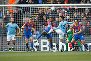 Crystal Palace defender Aaron Wan-Bissaka (29) tries to block a tap in from Manchester City midfielder David Silva (21) during the Premier League match between Crystal Palace and Manchester City at Selhurst Park, London, England on 14 April 2019.