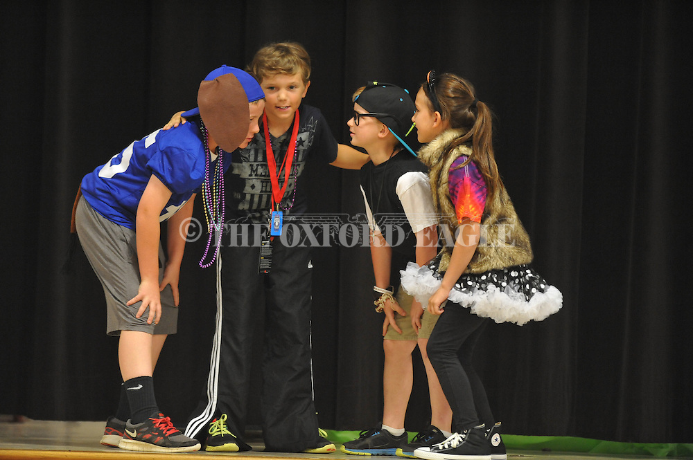 """Michael Harvey (from l.), Owen Collins, Ben Gardner, and Ella Tosh perform in """"The Brementown Rappers"""" at Oxford Elementary in Oxford, Miss. on Monday, May 20, 2013. Students did plays based upon seven fairy tales."""