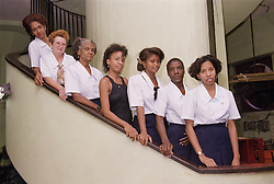 Group of women standing in line on staircase,