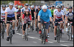 The Mayor of London Boris Johnson and his wife Marina (2nd Left) set off from the Olympic Park on their Ride London bike ride, a 100 mile cycle ride, London, United Kingdom<br /> Sunday, 4th August 2013<br /> Picture by Andrew Parsons / i-Images