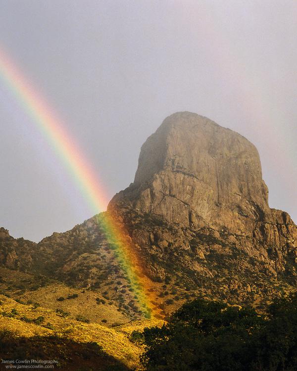 Rainbow in front of Baboquivari Peak in the Baboquivari Mountains on the Tohono O'ohdam Reservation in the Sonoran Desert of southern Arizona