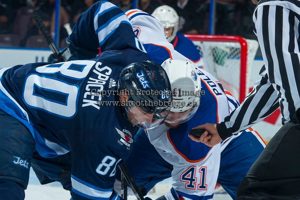PENTICTON, CANADA - SEPTEMBER 9: Michael Spacek #80  of Winnipeg Jets faces off against Evan Polei #41 of Edmonton Oilers on September 9, 2017 at the South Okanagan Event Centre in Penticton, British Columbia, Canada.  (Photo by Marissa Baecker/Shoot the Breeze)  *** Local Caption ***