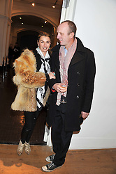 ASSIA WEBSTER and JOHNNIE SHAND-KYDD at the launch of the Krug Happiness Exhibition at The Royal Academy, 6 Burlington Gardens, London on 12th December 2011.