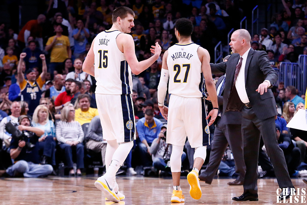 03 April 2018: Denver Nuggets center Nikola Jokic (15) is seen next to Denver Nuggets guard Jamal Murray (27) and Denver Nuggets head coach Michael Malone during the Denver Nuggets 107-104 victory over the Indiana Pacers, at the Pepsi Center, Denver, Colorado, USA.