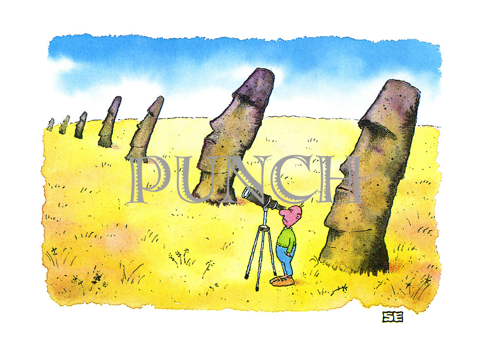 (A man on Easter Island stares through a telescope in the direction the famous heads are staring)