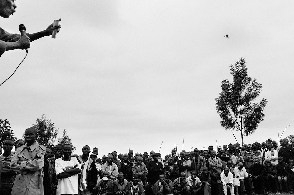 "NAIROBI, KENYA - AUGUST 28, 2011: A community leader addresses a crowd of predominantly Luo youth at a weekly ""kamkunji"" in Kisumundogo village. Kamkunji is Swahili for ""small gathering,"" and is a weekly venue for individuals to speak out about issues considered vital to community development. The gathering was started in 1990 when Kenyans were fighting for a multiparty government.<br />