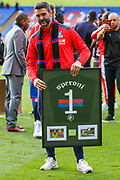 Crystal Palace goalkeeper Julian Speroni (1) poses with a plague awarded to him for 15 years service at Crystal Palace as he bids farewell to the fans after the Premier League match between Crystal Palace and Bournemouth at Selhurst Park, London, England on 12 May 2019.