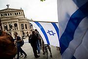 Frankfurt am Main | 04 Aug 2014<br /> <br /> Am Montag (04.08.2014) demonstrierten in Frankfurt am Main etwa 400 Menschen aus verschiedenen linken und linksradikalen Gruppen, aus der j&uuml;dischen Gemeinde und der Frankfurter Stadtgesellschaft gegen Antisemitismus und Judenhass. In den vergangenen Wochen war es in der Bankenstadt immer wieder zu antisemitischen Vorf&auml;llen wie Schmierereien an einer Synagoge, Hass-Kundgebungen oder einer eingeworfenen Scheibe bei einer j&uuml;dischen Familie und Beschimpfungen als &quot;Judenschweine&quot; gekommen.<br /> Hier: Die Flagge von Israel vor der Alten Oper.<br /> <br /> &copy;peter-juelich.com<br /> <br /> [No Model Release | No Property Release]