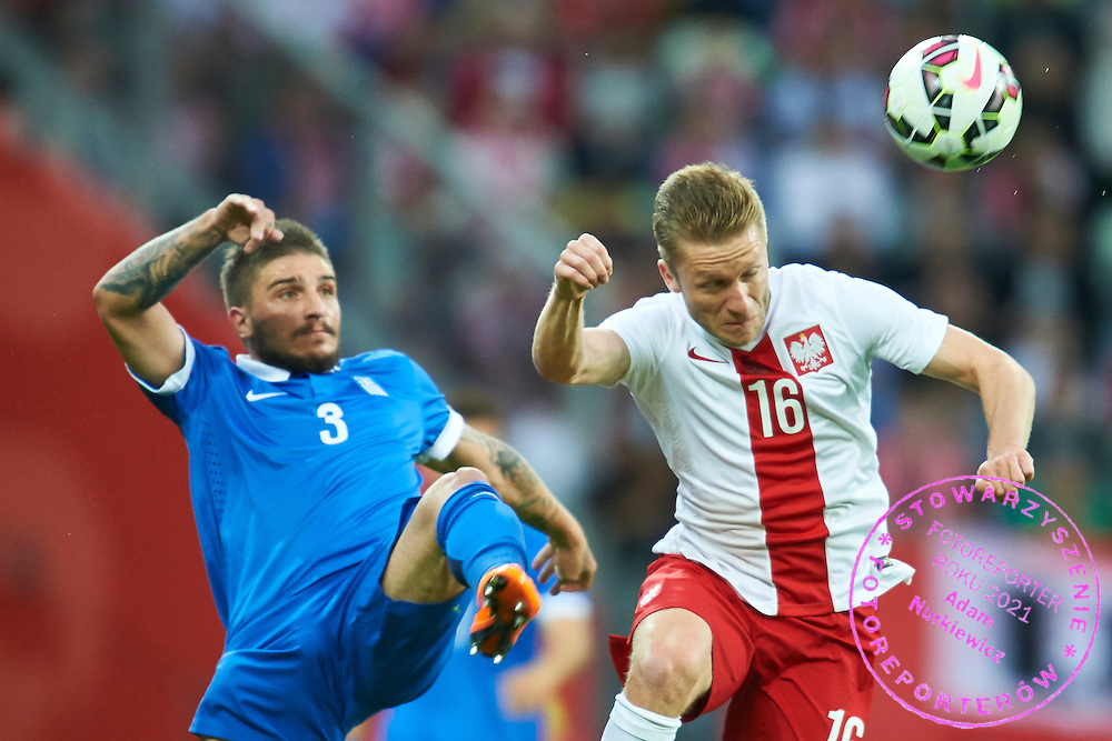 (R) Jakub Blaszczykowski from Poland fights for the ball with (L) Kostas Stafylidis from Greece during international friendly soccer match between Poland and Greece at PGE Arena Stadium on June 16, 2015 in Gdansk, Poland.<br /> Poland, Gdansk, June 16, 2015<br /> <br /> Picture also available in RAW (NEF) or TIFF format on special request.<br /> <br /> For editorial use only. Any commercial or promotional use requires permission.<br /> <br /> Adam Nurkiewicz declares that he has no rights to the image of people at the photographs of his authorship.<br /> <br /> Mandatory credit:<br /> Photo by &copy; Adam Nurkiewicz / Mediasport