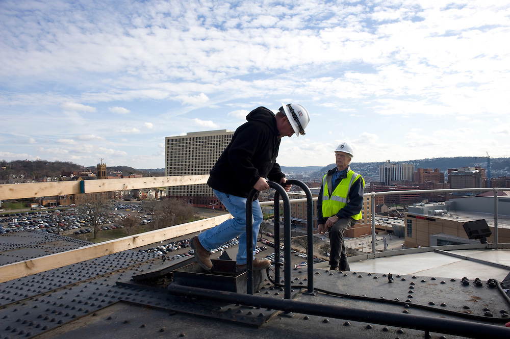 Project engineer Michael Maruschak begins the climb down from the top of the Civic Arena as demolition continues on the 50-year-old building.