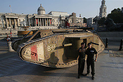 Members of the Royal Tank Regiment stand in front of a replica First World War Mark IV tank in London's Trafalgar Square marking the centenary of an armoured vehicle's first-ever deployment during the Battle of the Somme.