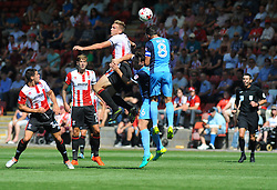 Danny Wright of Cheltenham Town loses the high ball to Robbie Weir of Leyton Orient - Mandatory by-line: Nizaam Jones/ JMP- 06/08/2016- FOOTBALL - The LCI Rail Stadium - Cheltenham, England - Cheltenham Town v Leyton Orient - Sky Bet League Two