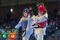 Burnaby, Canada. 20 November, 2016. WTF World Taekwondo Junior Championships Mi-Lauren Williams (GBR) blue, and Kristina Cerina (CRO) red compete in the female 68kg. semi-final won by Williams.  Photo: Peter Llewellyn