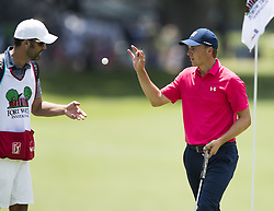May 26, 2018 - Fort Worth, TX, USA - FORT WORTH, TX - MAY 26, 2018 - Michael Greller tosses the golf ball to Jordan Spieth on the 18th green during the third round of the 2018 Fort Worth Invitational PGA at Colonial Country Club in Fort Worth, Texas (Credit Image: © Erich Schlegel via ZUMA Wire)