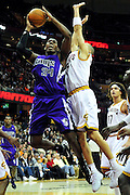 Oct. 30, 2010; Cleveland, OH, USA; Sacramento Kings center Jason Thompson (34) shoots over Cleveland Cavaliers shooting guard Anthony Parker (18) during the second quarter at Quicken Loans Arena. Mandatory Credit: Jason Miller-US PRESSWIRE