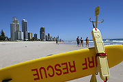 "Whether the name refers to the fine sand on its beaches or the money pouring in from commercialization, Brisbane's famed Gold Coast has become Australia's biggest tourist development. Every summer, throngs of just-graduated high school students invade Surfers Paradise, as this beach 30 miles southeast of the city is known. Their arrival kicks off what is sardonically called ""schoolies week."" Hungry Planet: What the World Eats (p. 33).  This image is featured alongside the Molloy family images in Hungry Planet: What the World Eats."