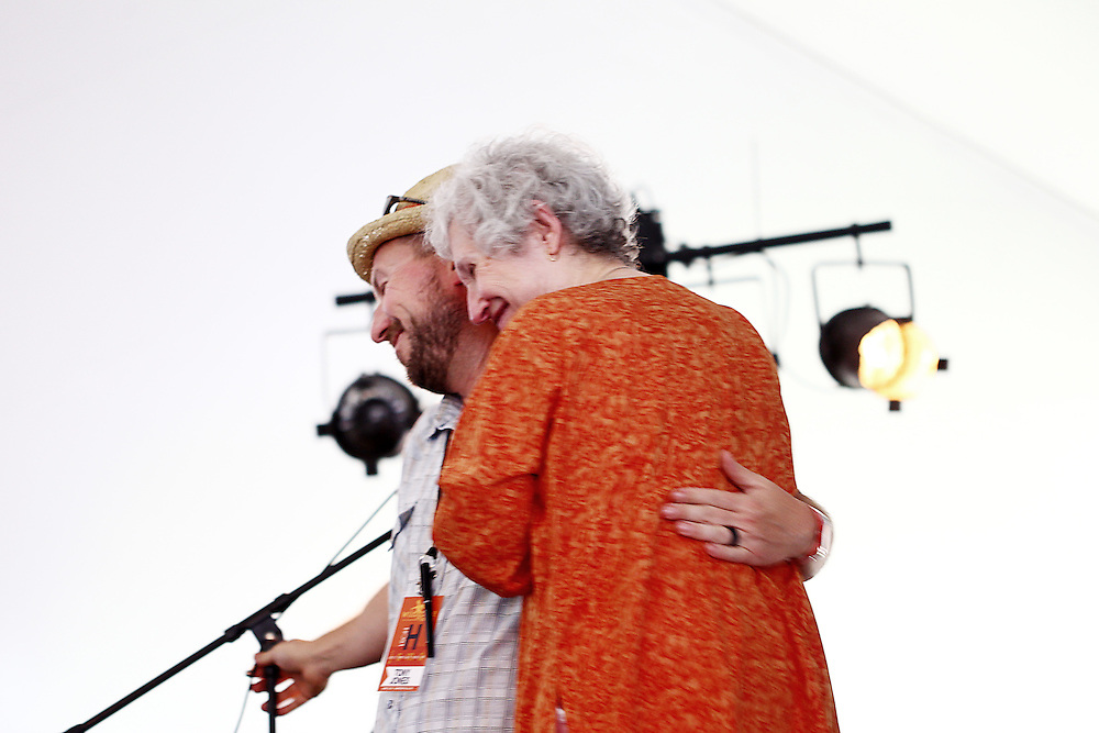 Tony Jones, left, introduces Phyllis Tickle at the Wild Goose Festival at Shakori Hills in North Carolina June 24, 2011.  (Photo by Courtney Perry)