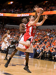 Bradley guard Sam Maniscalco (5) leaps past Virginia guard/forward Mamadi Diane (24) for a layup.  The Virginia Cavaliers fell to the Bradley Braves 96-85 in the semifinals of the 2008 College Basketball Invitational at the University of Virginia's John Paul Jones Arena in Charlottesville, VA on March 26, 2008.
