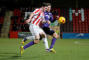 Jack dunn on the attack during the Sky Bet League 2 match between Cheltenham Town and Morecambe at Whaddon Road, Cheltenham, England on 16 January 2015. Photo by Alan Franklin.