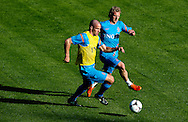 Dutch international football player Ron Vlaar in a duel with Dirk Kuyt (r)  during the training for the trainingcamp of the Netherlands national football team in Hoenderloo on May 28, 2012. AFP PHOTO/ ROBIN UTRECHT