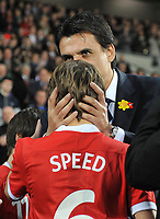 Football - International Friendly Gary Speed Memorial Match - Wales vs. Costa Rica<br /> Wales new manager Chris Coleman kisses the head of Gary Speeds son Ed before kick off at the Cardiff City Stadium