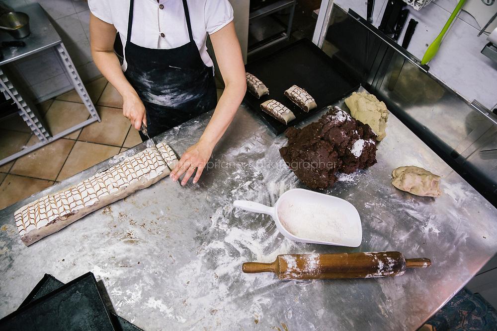 NAPLES, ITALY - 7 JUNE 2018: Anita Tagliatela prepares amarena cookies here at Pasticcielo, a bakery in Naples, Italy, on June 7th 2018.<br /> <br /> Pasticciello was founded 34 years ago by Lucia Tagliatela.