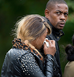 © London News Pictures. 19/09/2013. London, UK. Emotional family and friends of Mark Duggan at the scene where Mark Duggan was shot dead by armed police in an incident that sparked the 2011 London Riots. The family attended a visit by the Jury to the scene of the incident as part of an ongoing inquest into the death of Mark Duggan. Photo credit: Ben Cawthra/LNP