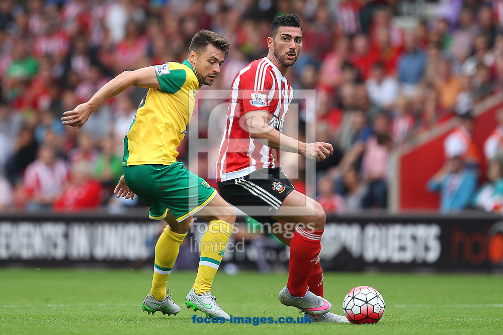 Russell Martin of Norwich and Graziano Pelle of Southampton in action during the Barclays Premier League match at the St Mary's Stadium, Southampton<br /> Picture by Paul Chesterton/Focus Images Ltd +44 7904 640267<br /> 30/08/2015