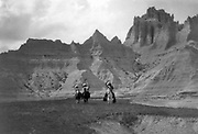Three Native Americans on horseback, mountains in backgrouand. c1905. Photograph by Edward Curtis (1868-1952).