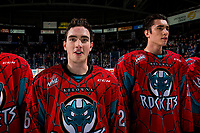 KELOWNA, CANADA - MARCH 16:  Liam Kindree #26 and Alex Swetlikoff #17 of the Kelowna Rockets line up for the shirt off your back presentation against the Vancouver Giants on March 16, 2019 at Prospera Place in Kelowna, British Columbia, Canada.  (Photo by Marissa Baecker/Shoot the Breeze)