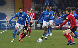 Niall Mason of Peterborough United in action against Lincoln City - Mandatory by-line: Joe Dent/JMP - 01/01/2020 - FOOTBALL - Sincil Bank Stadium - Lincoln, England - Lincoln City v Peterborough United - Sky Bet League One