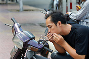Man on a motorbike sqashing a pimple.