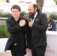 Director Cristian Mungiu and actor Valeriu Andriuta at the Dupa Dealuri film photocall at the 65th Cannes Film Festival. Saturday 19th May 2012 in Cannes Film Festival, France.