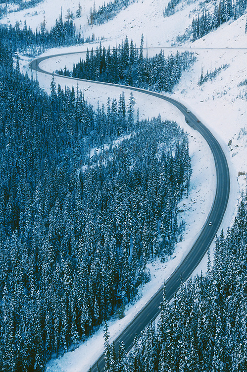 North Cascades Highway through Early Winters Valley, with winter snow; Okanogan-Wenatchee National Forest, Washington.