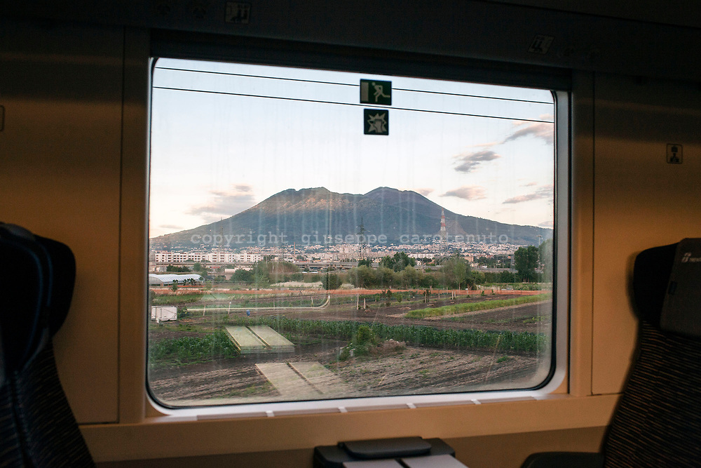 25 May 2017, Naples Italy - The Vesuvius seen from the coach of a train line Naples-Salerno.