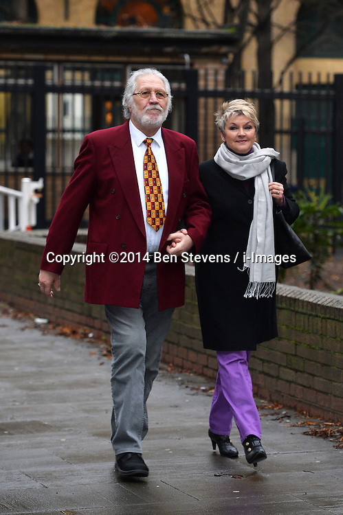 Veteran radio presenter Dave Lee Travis arrives at Southwark Court with his wife Marianne Griffin on Tuesday, 11th February 2014. <br /> Picture by Ben Stevens / i-Images