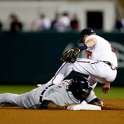 Mar 7, 2013; Lake Buena Vista, FL, USA; Detroit Tigers first baseman Prince Fielder (28) collides with Atlanta Braves shortstop Tyler Pastornicky (1) on a force out at second base during the top of the fourth inning of a spring training game at Champion Stadium. Mandatory Credit: Derick E. Hingle-USA TODAY Sports