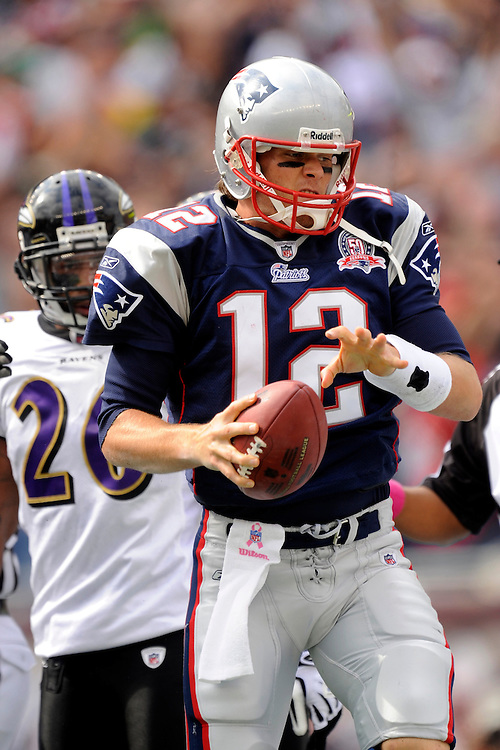 FOXBORO, MA - OCTOBER 04: Tom Brady #12 of the New England Patriots looks to spike the ball after scoring a touchdown against the Baltimore Ravens  at Gillette Stadium on October 4, 2009 in Foxboro, Massachusetts. The Patriots defeated the Ravens 27 to 21. (Photo by Rob Tringali) *** Local Caption *** Tom Brady