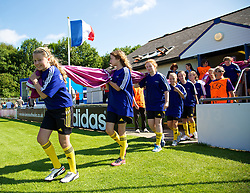 HAVERFORDWEST, WALES - Sunday, August 25, 2013: Flag bearers carry out the UEFA banner before the Group A match of the UEFA Women's Under-19 Championship Wales 2013 tournament at the Bridge Meadow Stadium. (Pic by David Rawcliffe/Propaganda)