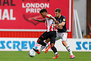 Brentford forward Ollie Watkins (11) tussles with Charlton Athletic defender Tom Lockyer (5) during the EFL Sky Bet Championship match between Brentford and Charlton Athletic at Griffin Park, London, England on 7 July 2020.