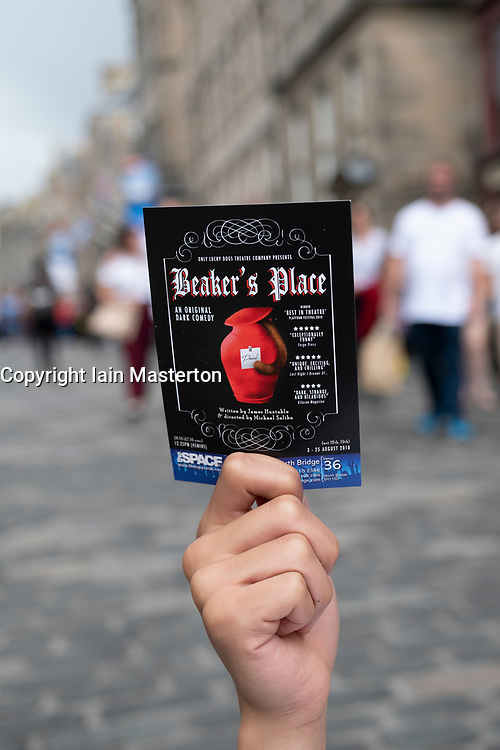 Edinburgh, Scotland, UK; 2 August, 2018. On day before official opening of the Edinburgh Festival Fringe 2018, performers are active on the Royal Mile handing out fliers and meeting the public. Pictured; flier for  Beaker's Place production by Only Lucky Dogs Theatre Company.