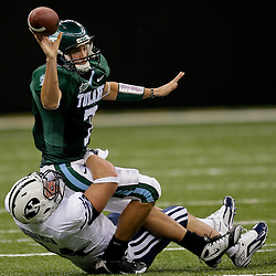 Sep 12, 2009; New Orleans, LA, USA;  Tulane Green Wave quarterback Joe Kemp (7) throws as BYU Cougars defensive tackle Jan Jorgensen (84) pressures during the first quarter at the Louisiana Superdome.  Mandatory Credit: Derick Hingle-US PRESSWIRE