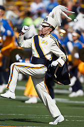 Member of the UCLA Bruins marching band performs before a football game at Memorial Stadium, University of California Berkeley, California, United States of America