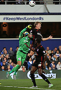 Alex Smithies (QPR Goalkeeper) getting beaten to the ball by Tom Miller and then the ball eventually hitting the bar during the Capital One Cup match between Queens Park Rangers and Carlisle United at the Loftus Road Stadium, London, England on 25 August 2015. Photo by Matthew Redman.