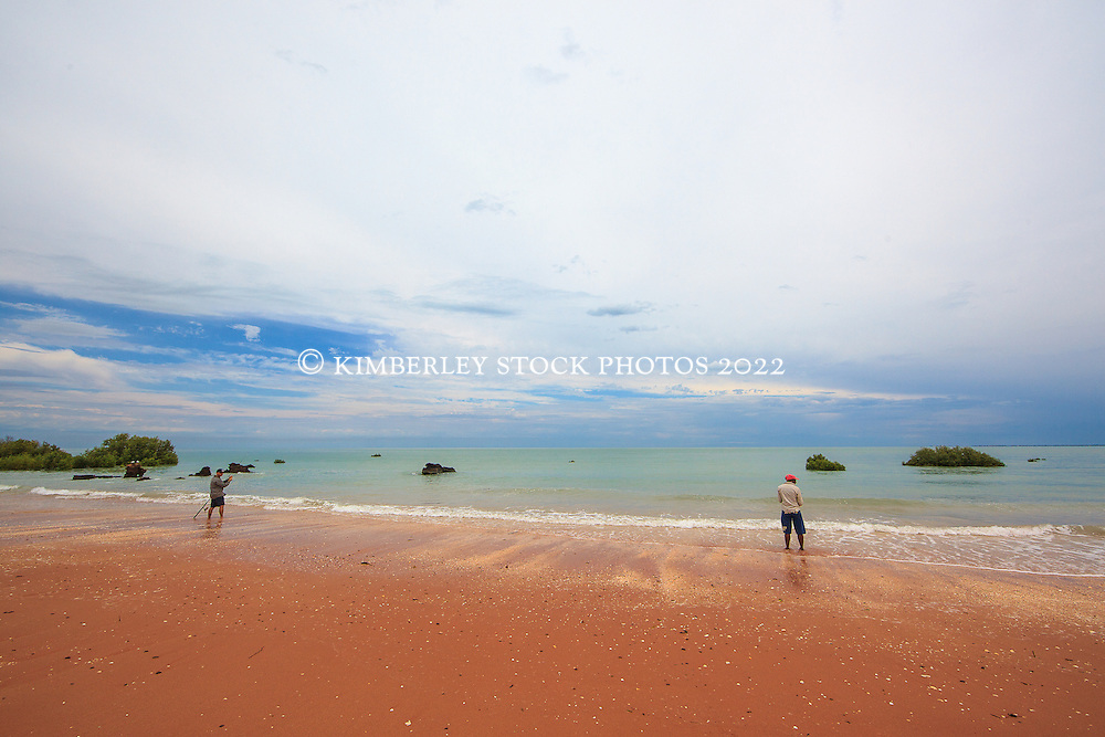 Two fisherman on the shores of Crab Creek in Roebuck Bay near Broome.