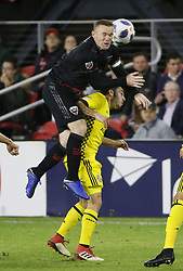 November 1, 2018 - Washington, DC, USA - D.C. United forward Wayne Rooney (9) and Columbus Crew SC defender Milton Valenzuela (19) collide during the first half of the MLS Cup knockout round playoff match at Audi Field in Washington, D.C., on Thursday, Nov. 1, 2018. (Credit Image: © Adam Cairns/Columbus Dispatch/TNS via ZUMA Wire)