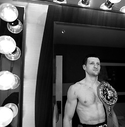 Carl Froch poses with the WBC belt in his changing room after beating Jermain Taylor. USA , 26th April 2009.