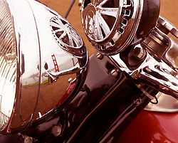 motorcycle detail and reflection of Golden Gate Bridge in San Francisco