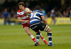 Gloucester's Billy Burns and Bath's Taulupe Faletau during the Aviva Premiership match at the Recreation Ground, Bath.